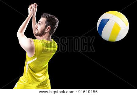 Volleyball player on yellow uniform on black background