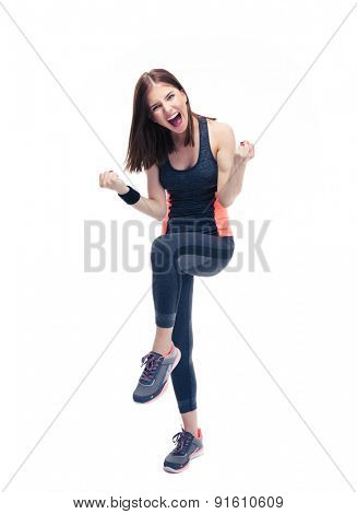 Full length portrait of a fitness woman celebrating her victory isolated on a white background