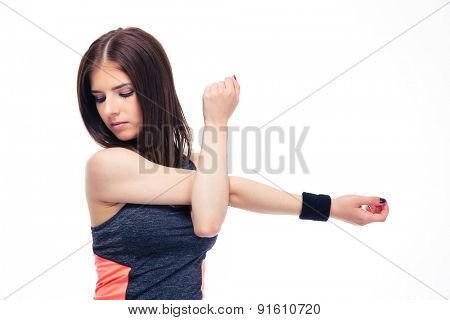 Pretty fitness woman stretching hands isolated on a white background