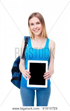Smiling young girl showing tablet computer screen isolated on a white background. Looking at camera