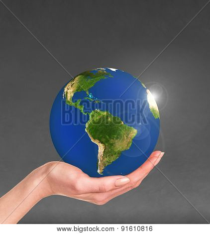 Planet earth in a human hand