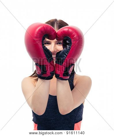 Happy sporty woman in boxing gloves making heart shape isolated on a white background