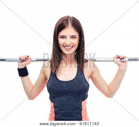Smiling woman working out with barbell isolated on a white background. Looking at camera