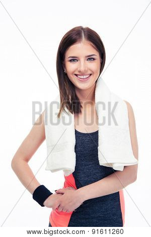 Portrait of a cheerful fitness woman with towel isolated on a white background. Looking at camera