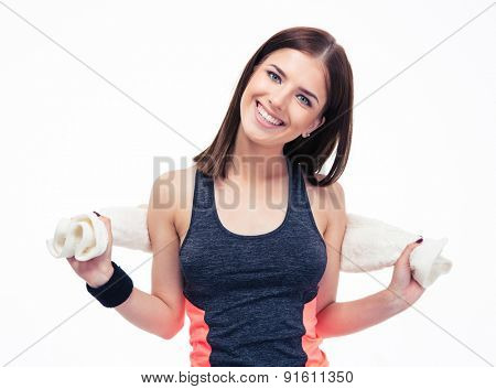 Portrait of a happy sporty woman with towel isolated on a white background. Looking at camera