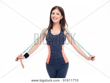 Smiling beautiful woman in sports wear standing with skipping rope isolated on a white background. Looking at camera