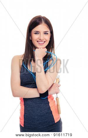 Happy beautiful woman standing with skipping rope isolated on a white background. Looking at camera