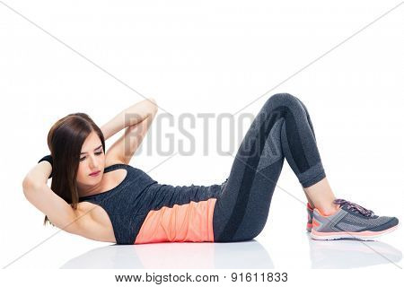 Young woman making abdominal exercises isolated on a white background