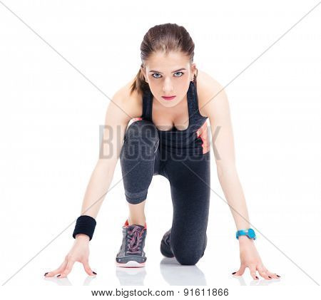 Runner sporty woman in start position isolated on a white background