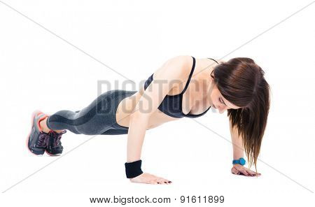 Young sporty woman doing push ups isolated on a white background