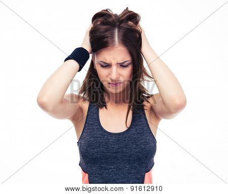 Young fitness woman with headache isolated on a white background