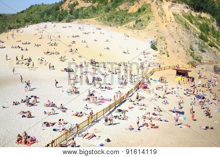 LYUBERTSY, RUSSIA - MAY 23, 2014: Many people sunbathe on the sandy beach of the Lyubertsy career