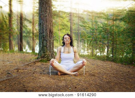 Woman Meditate In The Forest
