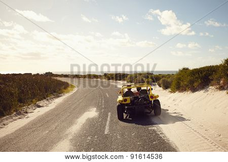 Young Couple Driving Down A Open Road
