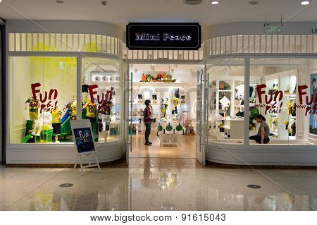 SHENZHEN, CHINA - MAY 25, 2015: COCO Park shopping center interior. Shenzhen is a major city, situated immediately north of Hong Kong Special Administrative Region.