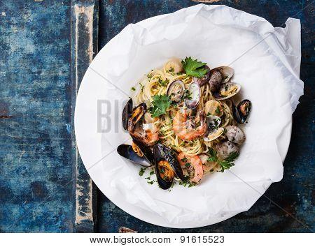 Seafood Pasta - Spaghetti With Clams, Prawns, Sea Scallops On White Plate