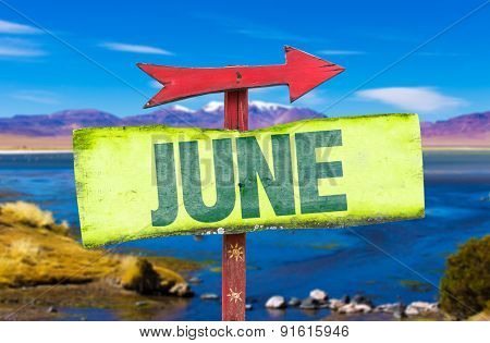June direction sign with landscape background