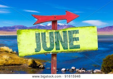 June direction sign with landscape background