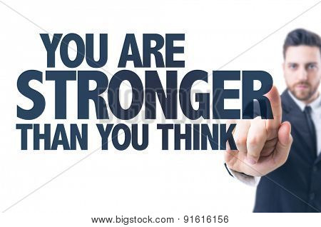 Business man pointing the text: You Are Stronger Than You Think