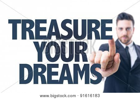 Business man pointing the text: Treasure Your Dreams