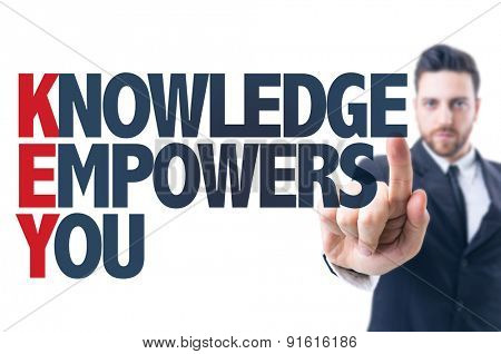 Business man pointing the text: Knowledge Empowers You