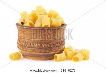 Rigatoni italian pasta in wood bowl, isolated on white background