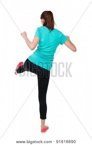 skinny woman funny fights waving his arms and legs. Rear view people collection.  backside view of person.  Isolated over white background. Athlete holds with his left foot.