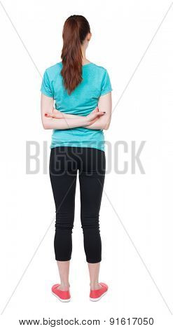 back view of standing young beautiful  woman. girl  watching. Rear view people collection.  backside view of person.  Isolated over white background. Hands behind his back runner looks ahead.