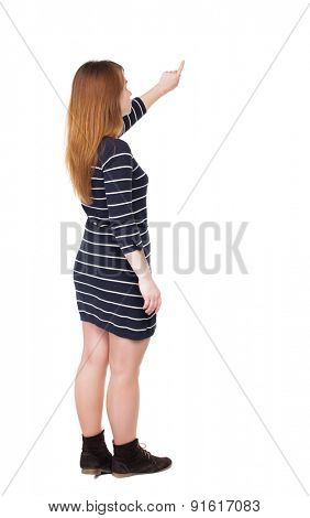 back view woman in a dress protects hands from what is falling from above. Rear view people collection.  backside view of person.  Isolated over white background.