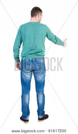 Back view of  man thumbs up. Rear view people collection. backside view of person. Isolated over white background.  The guy in the green jacket shows the big finger to someone at the bottom