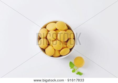 overhead view of bowl with soft sponge biscuits decorated with piece of mint