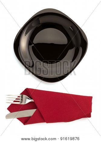 napkin with plate, fork and knife isolated on white background