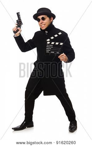 Young man with gun and clapper-board isolated on white