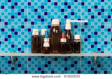 Medicine bottles on shelf