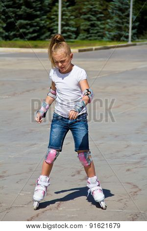 Cute Girl On Roller Skates In Summer