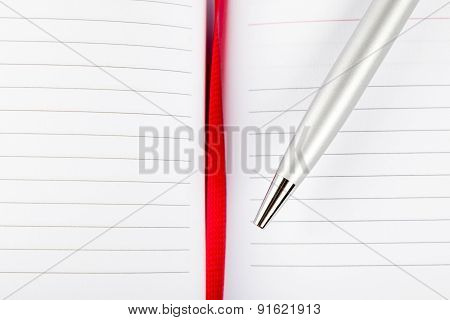 Pen On Notebook With Red String