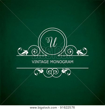 Monogram of the letter U, in retro floral style on green chalkboard background.