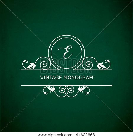 Monogram of the letter E, in retro floral style on green chalkboard background.