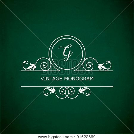 Monogram of the letter G, in retro floral style on green chalkboard background.