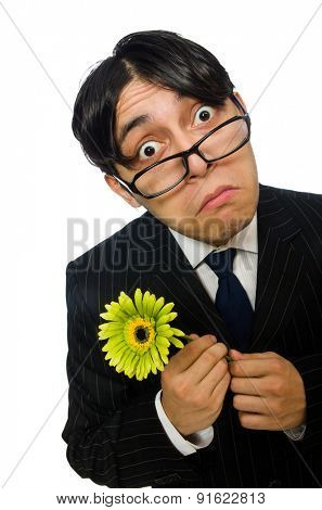 Young man in black costume with flower isolated on white