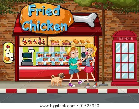 Children eating junkfood in front of fried chicken shop