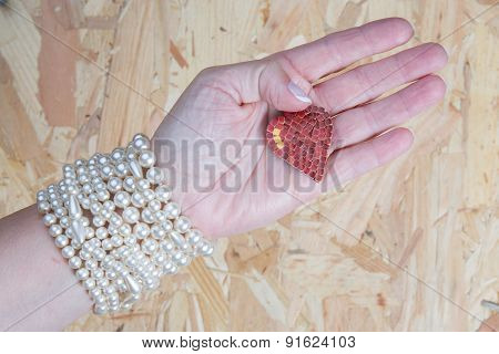 Woman Or Girl Holding Heart In Her Hand To Give To Someone