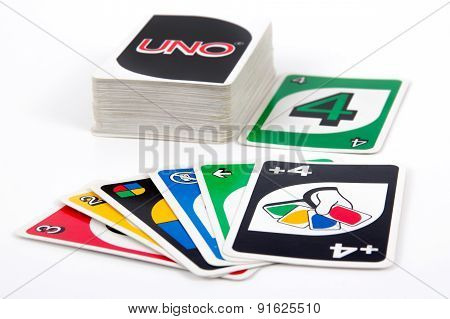 Uno card game on white table