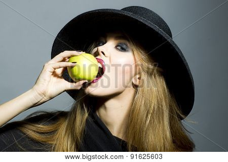Pretty Young Woman With Apple