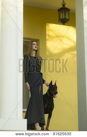 Beautiful Woman In Black Dress With Mastiff