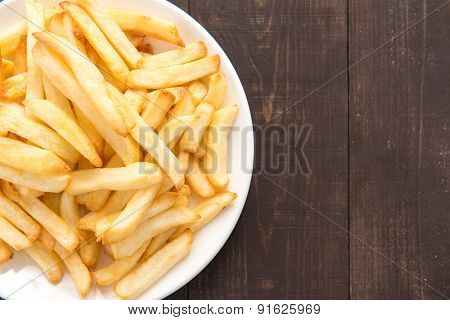 French Fries On White Dish On Wooden Background