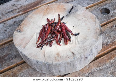 Drying The Red Hot Chili Pepper On The Chopping Block