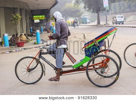Rickshaw Rider Waits For Passengers