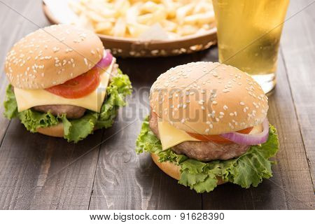 Bbq Hamburger With French Fries And Beer On The Wooden Background.