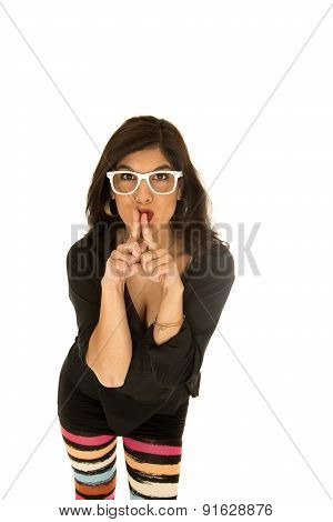 Pretty Tan Female Leaning Forward With Her Fingers To Her Lips